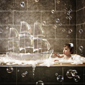 Young man relaxing in a hot bubble bath